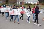 Flash Mob Participants with Posters at Visitor Parking Lot by New Fraternity Row by Patricia Herrera and Mariela Méndez